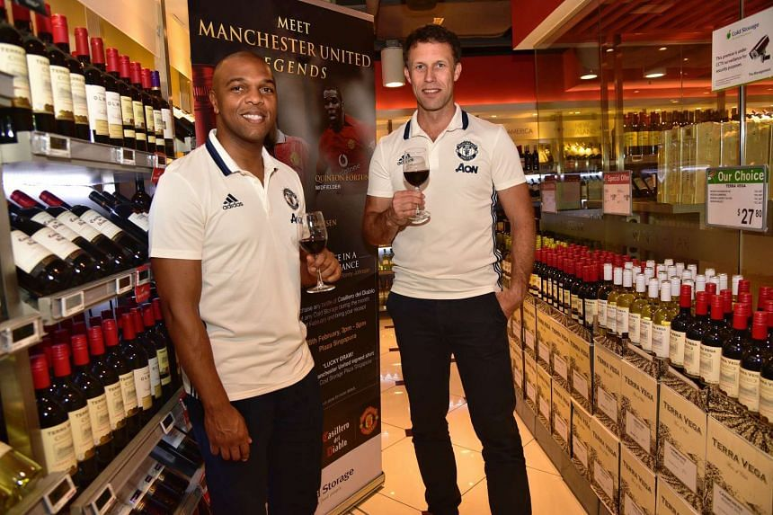 From left to right : Former Manchester United players Quinton Fortune and Ronnie Johnsen are in Singapore to promote a brand of red wine for the Red Devils.