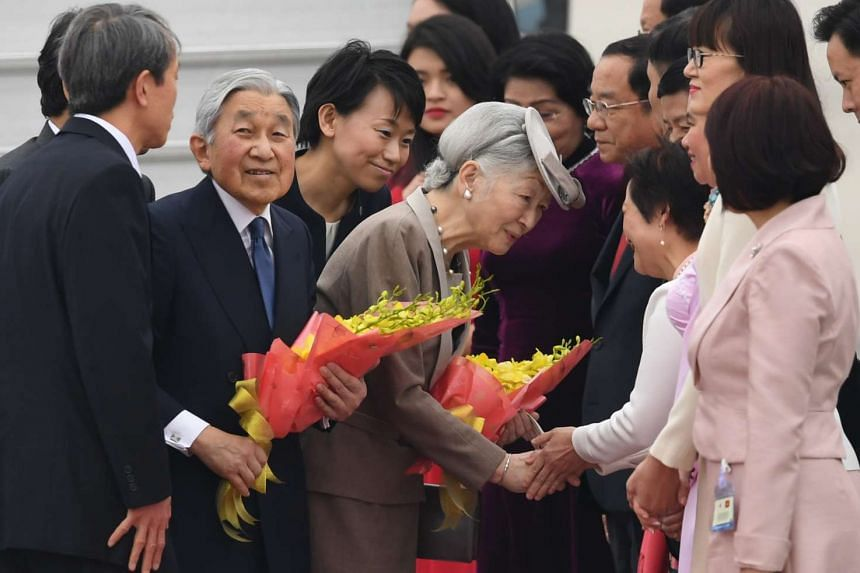 Japanese Emperor Akihito and his wife, Empress Michiko, being greeted by Vietnamese officials at Hanoi International Airport on Feb 28, 2017.