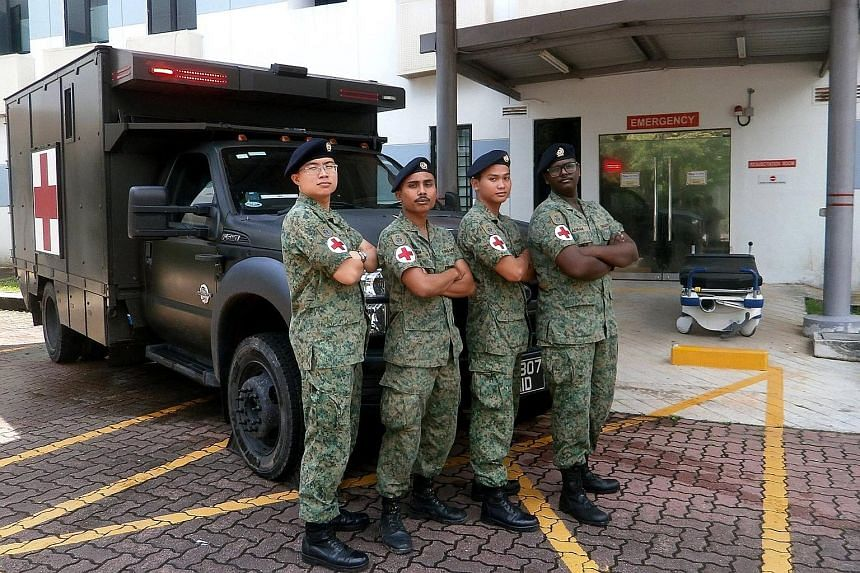 From left: Lt (Dr) Yap, 3SG Muhamad Nur Yassin, Cpl Muhammad Zakaria and Lance Cpl Adiram from Rocky Hill Medical Centre acted fast by performing emergency resuscitation on Mr Phua while he was being taken to SGH. Mr Phua had suffered a cardiac arres