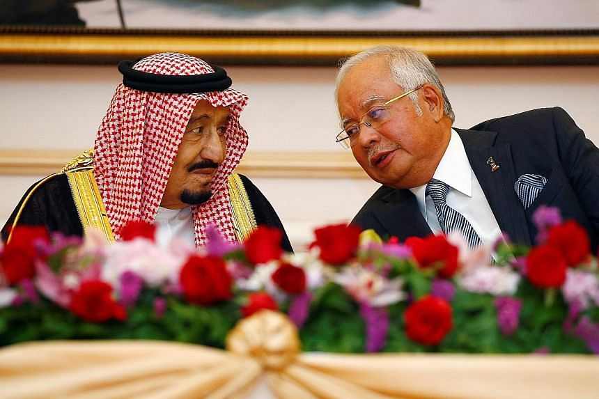 King Salman and Prime Minister Najib at a ceremony yesterday to mark the signing of memorandums for cooperation on economic, labour, science and education issues.
