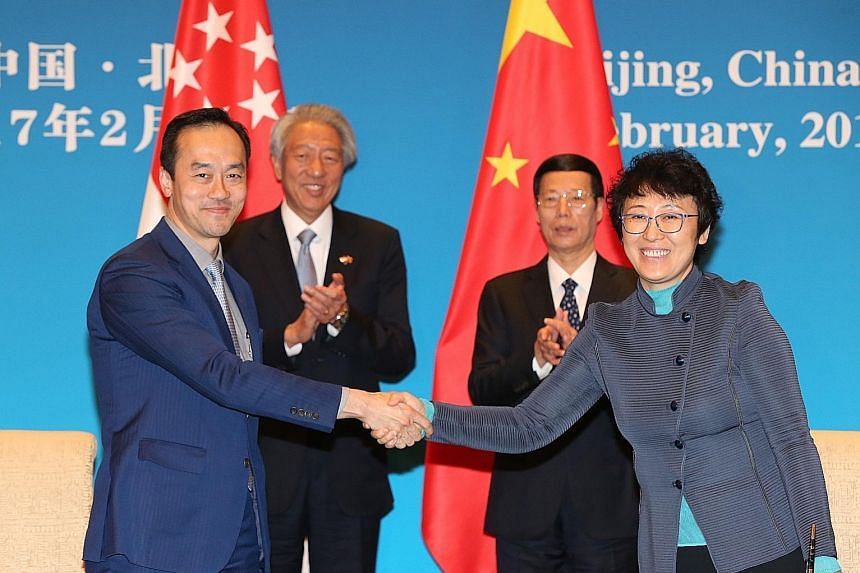 Dr Koh Poh Koon, Minister of State for National Development, and Ms Huang Yan, China's Vice-Minister for Housing and Urban-Rural Development, representing their ministries in agreeing to form a joint expert panel to advise on the development of the T