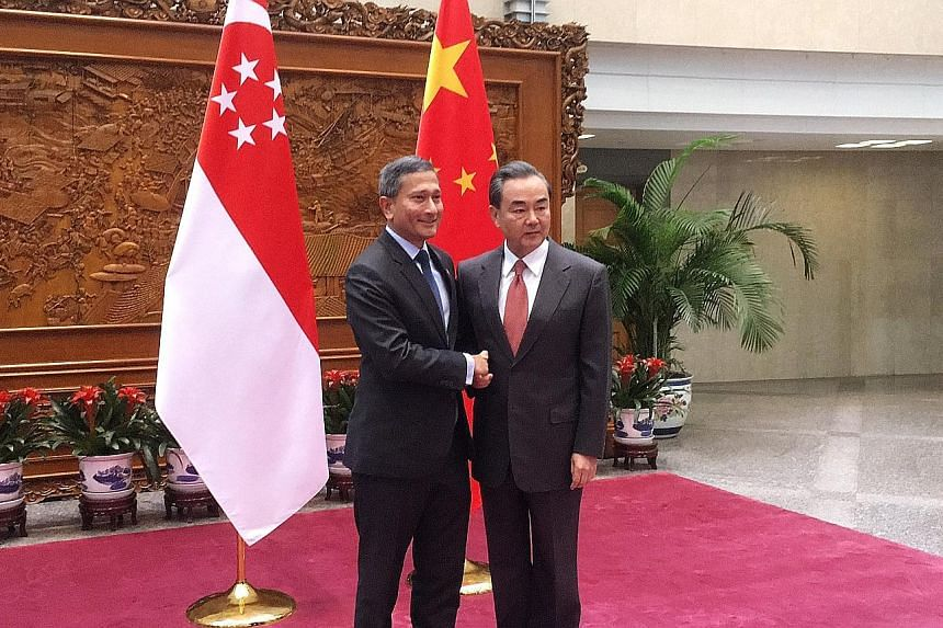 Foreign ministers Dr Balakrishnan and Mr Wang meeting in Beijing yesterday on the sidelines of the Joint Council for Bilateral Cooperation.