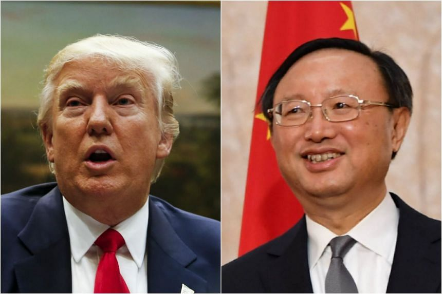 US President Donald Trump (left) held his first face-to-face meeting with State Councillor Yang Jiechi.