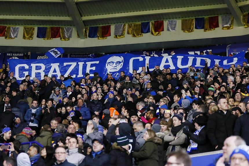 Leicester City fans with a banner for former Leicester City manager Claudio Ranieri before their English Premier League match with Liverpool.