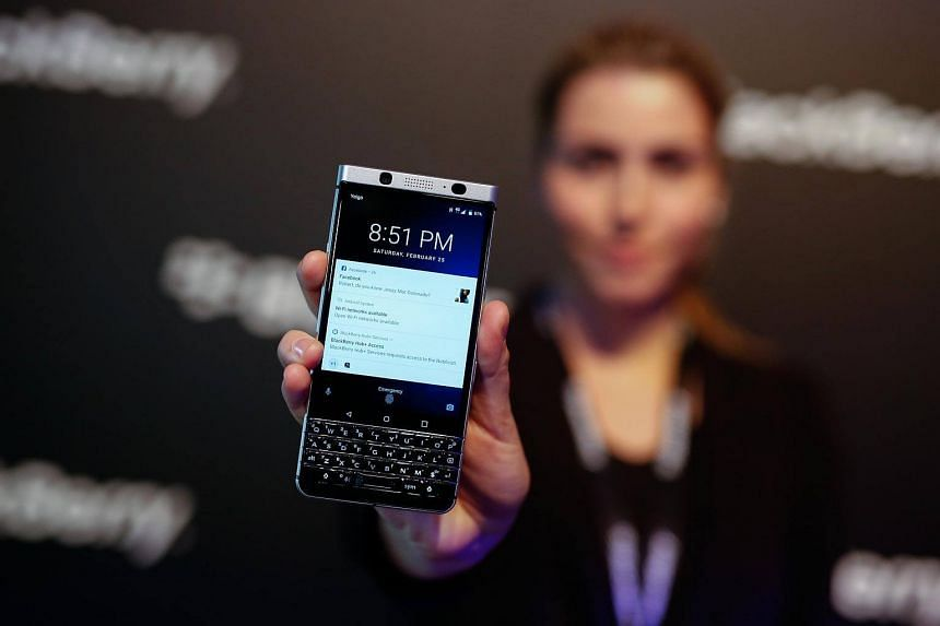 An attendee holds the Blackberry Keyone smartphone, during its launch event ahead of the Mobile World Congress (MWC) in Barcelona, Spain, on Feb 25, 2017.