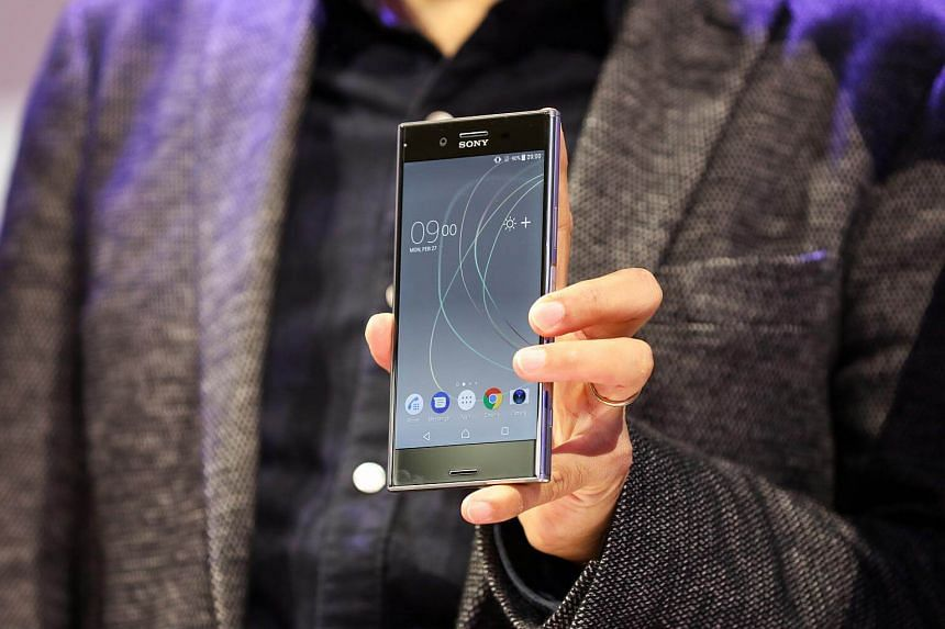 A Sony Corp. executive holds a Sony Corp. Xperia XZ Premium smartphone on display following its launch on the opening day of the Mobile World Congress (MWC) in Barcelona, Spain, on Feb 27, 2017.