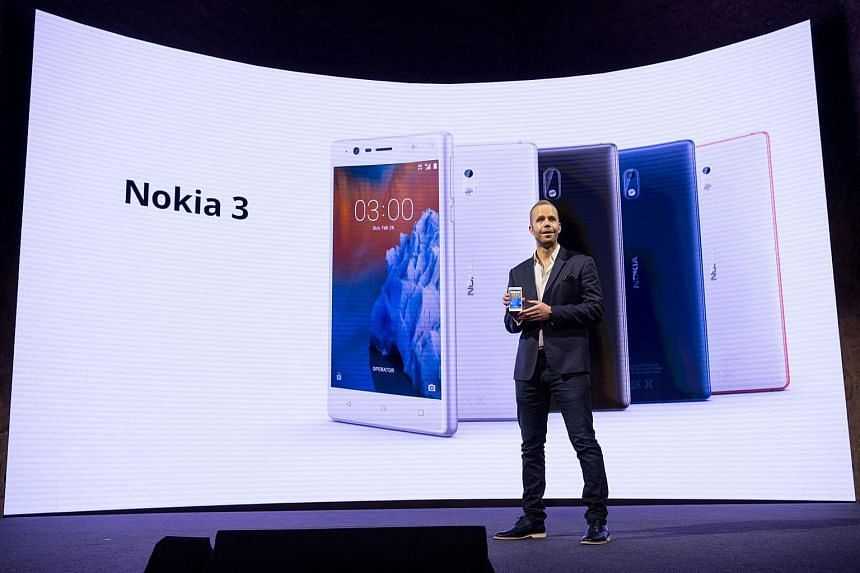 """HMD global Chief product Officer Juho Sarvikas presents his company's new phone """"Nokia 6"""" during a press conference in Barcelona on Feb 26, 2017, the eve of the start of the Mobile World Congress."""