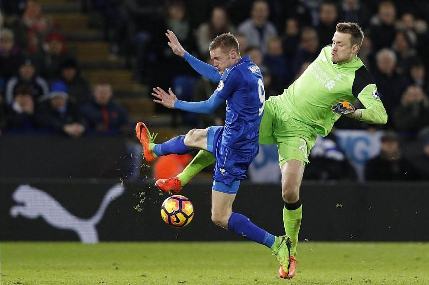 Liverpool's Belgian goalkeeper Simon Mignolet (right) vies with Leicester City's English striker Jamie Vardy during the English Premier League football match between Leicester City and Liverpool, on Feb 27, 2017.
