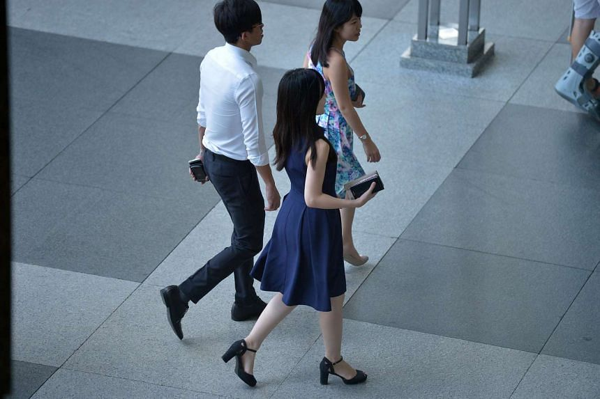 Office workers during lunch hour at Raffles Place.