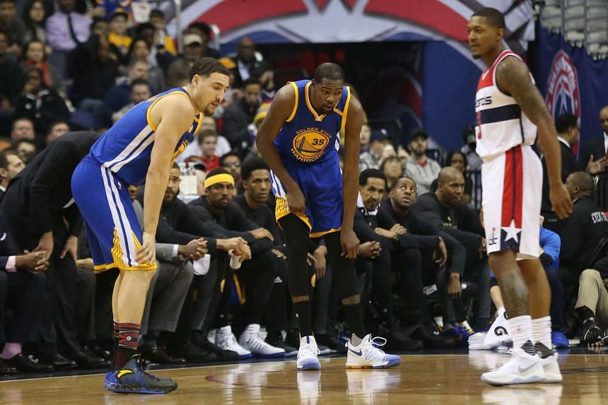 Golden State Warriors forward Kevin Durant (#35) holding his knee after getting injured during the NBA match against the Washington Wizards on Feb 28, 2017.