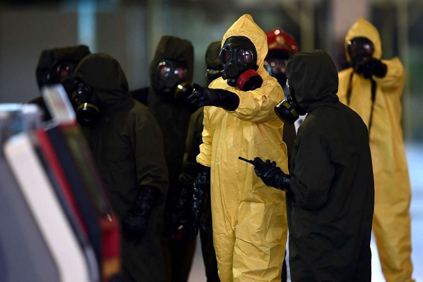 Members of Malaysia's Hazmat team conducting a decontamination operation at the departure terminals of KLIA2 on Feb 26, 2017.