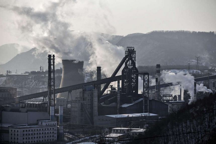 Water vapor and smoke rise from a Tonghua Iron & Steel Group Co. plant in the Erdaojiang district in Tonghua, Jilin province, China, on Jan 6, 2016.