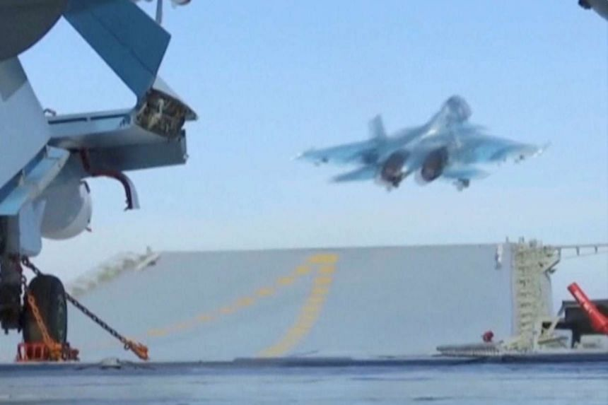 A jet takes off from a Russian aircraft carrier near the coast of Syria.