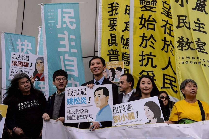 From left to right: Pro-democracy lawmakers Leung Kwok Hung, Nathan Law, Edward Yiu and Lau Siu Lai arrive at the High Court in Hong Kong on Dec15, 2016, after the government launched a legal bid to unseat them.