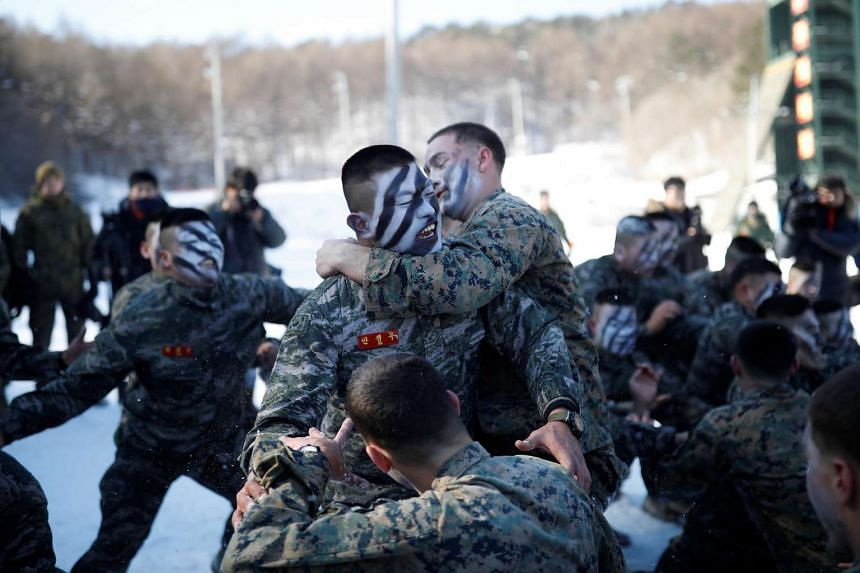 South Korean and US Marines participate in a winter military drill in Pyeongchang, South Korea, on Jan 24, 2017.