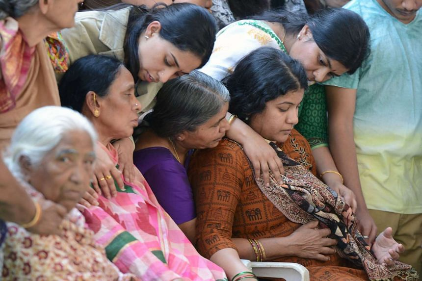 Sunayana Dumala (right), the wife of murdered Indian engineer Srinivas Kuchibhotla, is consoled by family members at his funeral.