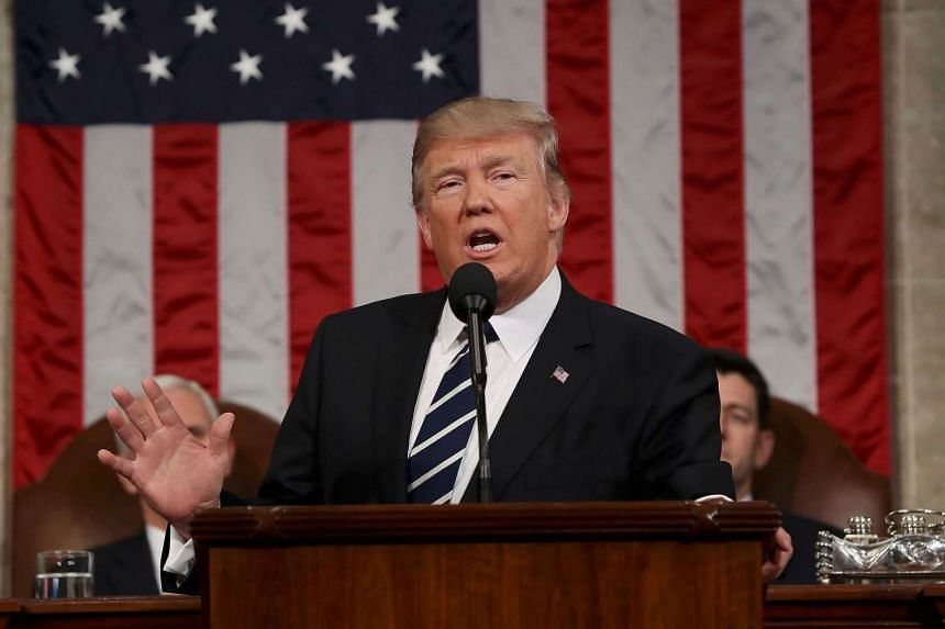 US President Donald J. Trump delivers his first address to a joint session of Congress from the floor of the House of Representatives in Washington, DC.