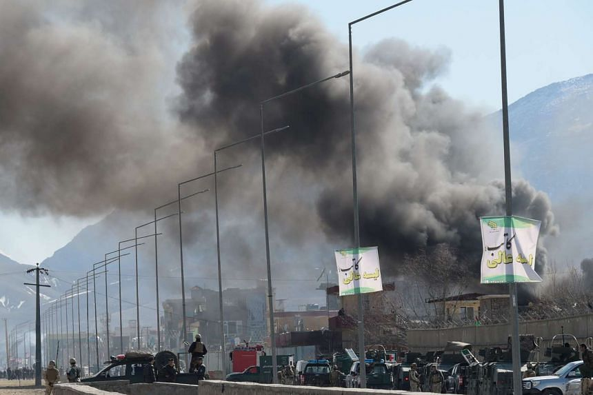 Smoke rises from an Afghan police district headquarters building after a suicide car bombing in Kabul on March 1, 2017.