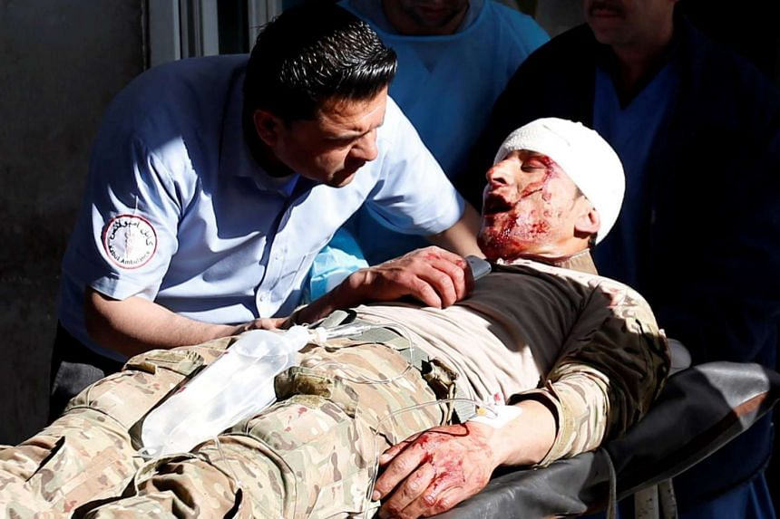 A doctor talks to an injured Afghan security force memberl in a hospital after attacks in Kabul, March 1, 2017.