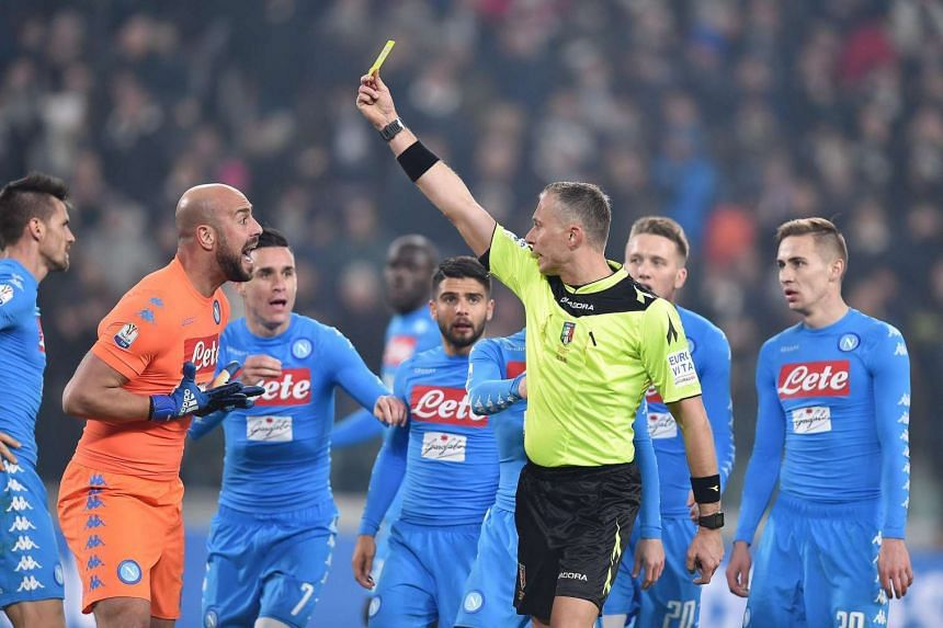 Napoli goalkeeper Pepe Reina protesting with referee Paolo Valeri after getting a yellow card during their match against Juventus on Feb 28, 2017.