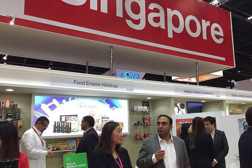 Representatives of Singapore's food manufacturers showcasing their products at the Gulfood 2017 exhibition in Dubai. The Middle East is a key market for Singapore food, with US$52 billion in sales expected this year.