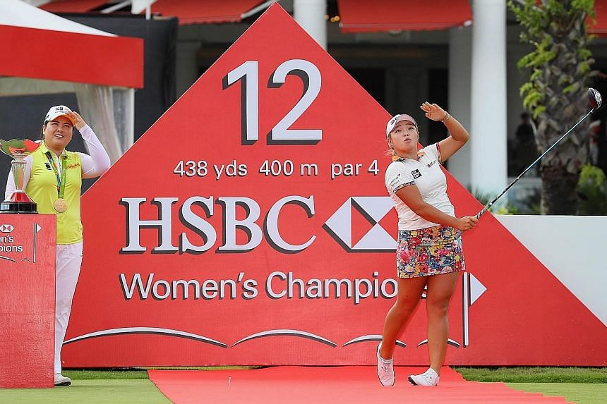 World No. 12 Park In Bee, the winner of the 2015 HSBC Women's Champions title, looks on as defending champion Jang Ha Na, the world No. 6, finds her range at the Sentosa Golf Club yesterday.