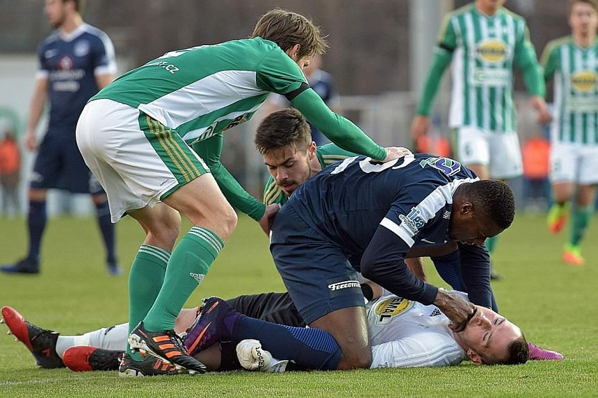 Togolese striker Francis Kone reacts first to help rival player Martin Berkovec. The goalkeeper swallowed his tongue after clashing with a team-mate. Kone pulled out his tongue just as medics arrived.