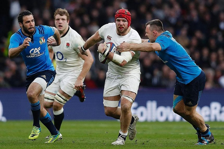 Italy's Simone Favaro (right) tackles fellow flanker James Haskell of England during their Six Nations clash at Twickenham. Haskell and skipper Dylan Hartley tried to ask the referee about the rules of the game during England's 36-15 victory on Sunda