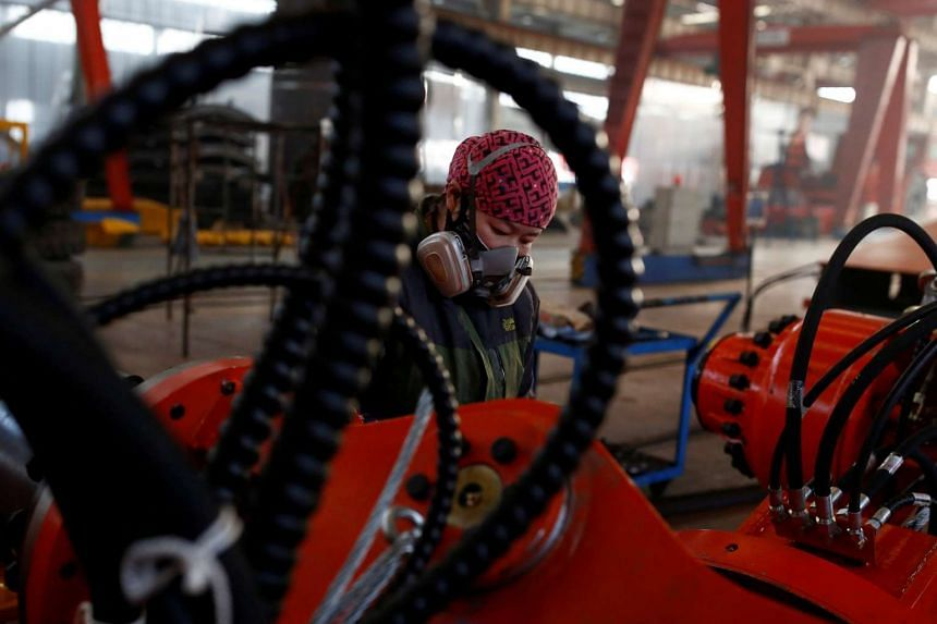 A woman working in the Tianye Tolian Heavy Industry Co. factory in Qinhuangdao, in Hebei province, China, on Dec 2, 2016.
