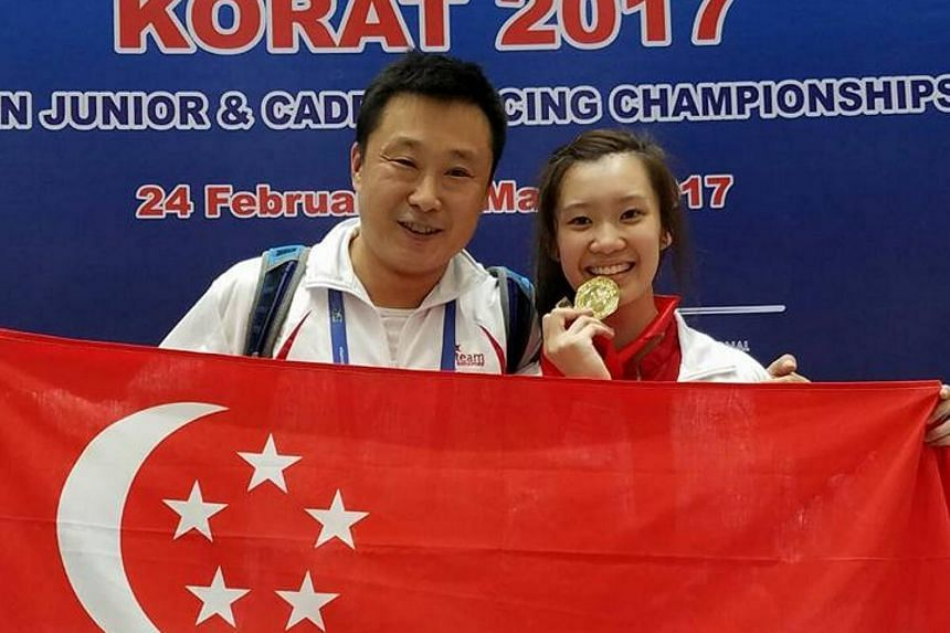 Esther Lai posing with national epee coach Fu Hao after winning the gold medal in the women's junior epee at the Asian Junior and Cadet Fencing Championships on March 1, 2017.