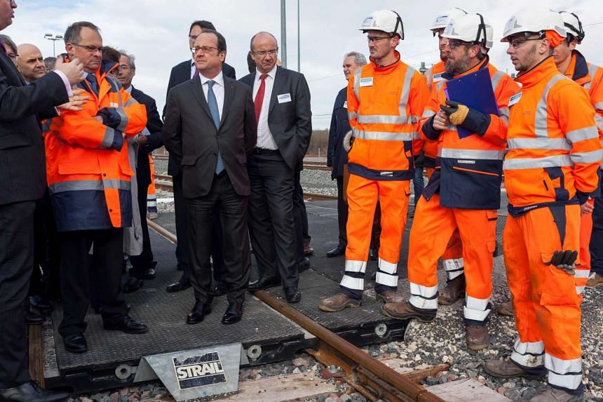 French President Francois Hollande attends the inauguration of a new high-speed rail line, in Villognon, central France.