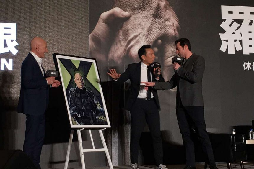 Sir Patrick Stewart receiving a gift of a hand-painted movie poster of his X-Men character Professor Charles Xavier from Chuan Mei Theatre in Taiwan