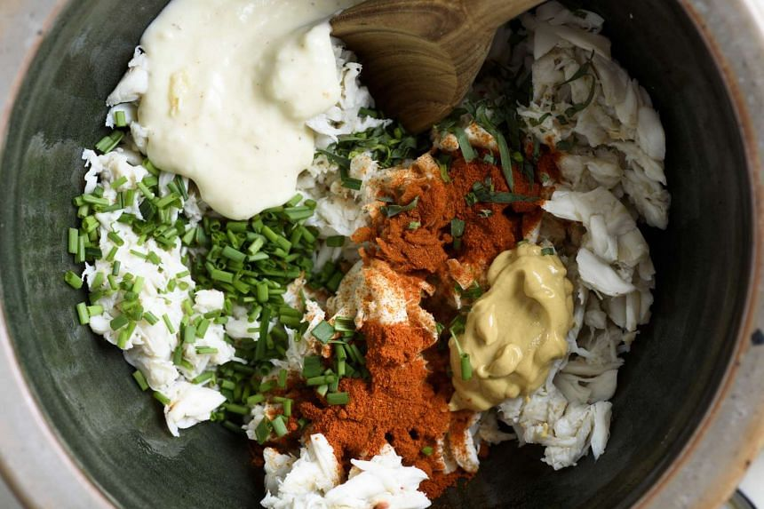 Mix the cooked crab with herbs and ingredients such as Dijon mustard.