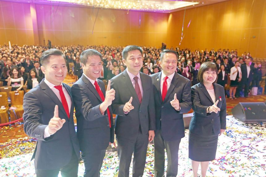 Mr Tan (centre) posing for a group shot at the ERA conference yesterday with (from left) Mr Chu, Mr Chua, key executive officer Eugene Lim and chief operating officer Doris Ong.