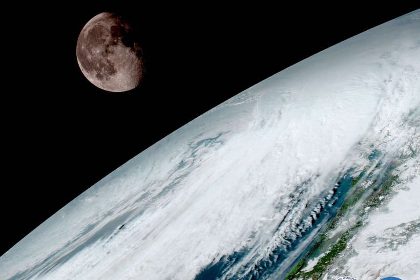 An image from the GOES-16 weather satellite shows the Earth and Moon.