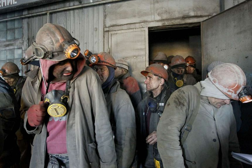 A January 2017 file photo shows miners being evacuated from a Ukrainian mine in the rebel-held city of Donetsk after shelling caused a power-cut.
