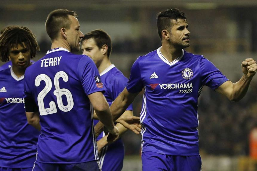 Chelsea's Diego Costa celebrates scoring their second goal with John Terry at the FA Cup Fifth Round in Molineux on Feb 18, 2017.