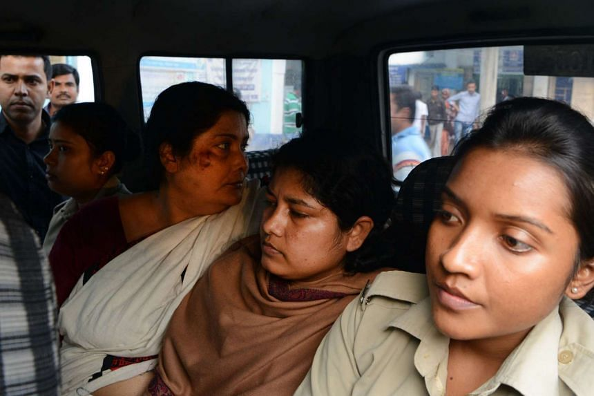Suspects  in the child trafficking case Chandana Chakraborty (second left) and Sonali Mondal (second right) are escorted from a police station for medical checks on Feb 21, 2017.