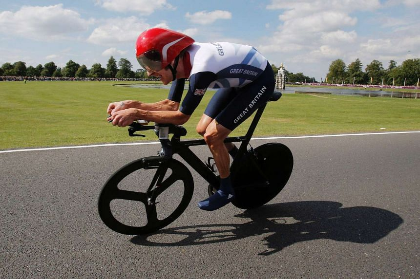 A 2012 photo shows Britain's Bradley Wiggins racing to win in the London 2012 Olympic Games men's individual time trial road cycling event.