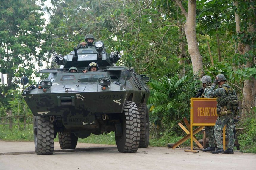 Government troops conduct checkpoint operations for the German kidnap victim who was believed to be executed by Islamist militant group Abu Sayyaf in Indanan town, Sulu province, Philippines on Feb 27, 2017.