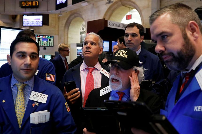 Traders works on the floor of the New York Stock Exchange, March 1, 2017.