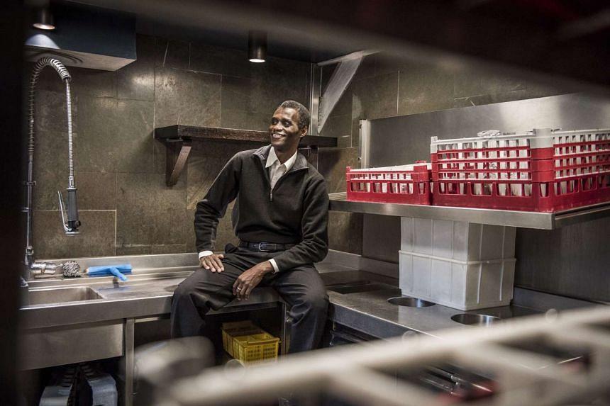 Employee Ali Sonko poses in the kitchen of Noma restaurant in Copenhagen, Denmark, Feb 28, 2017.