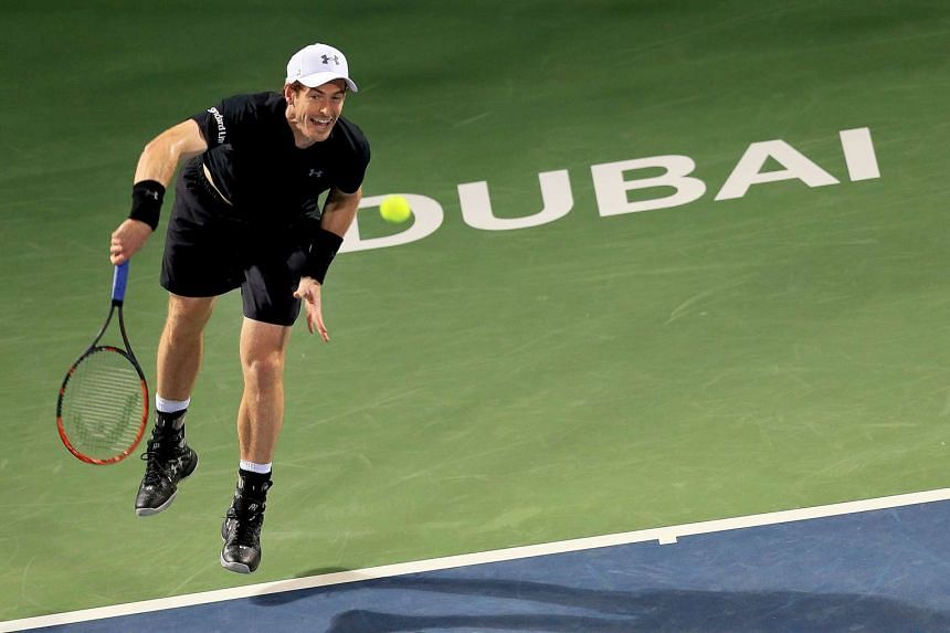 Britain's Andy Murray in action against Spain's Guillermo Garcia-Lopez during their second round match.