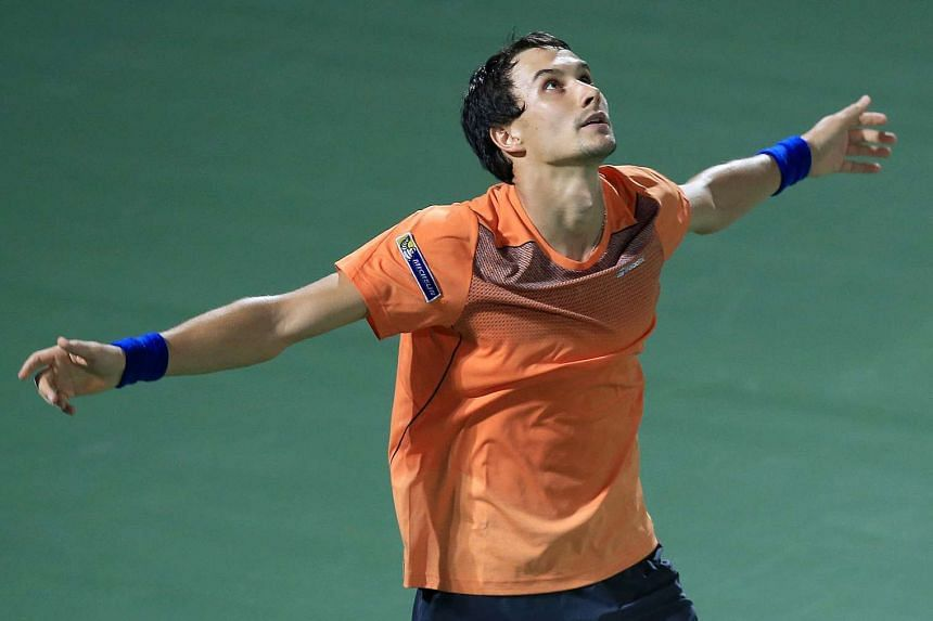 Evgeny Donskoy of Russia reacts after winning against Switzerland's Roger Federer.