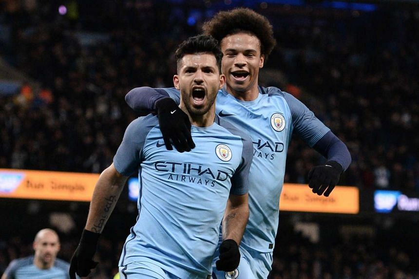 Manchester City's Argentinian striker Sergio Aguero (left) celebrates scoring his team's second goal.