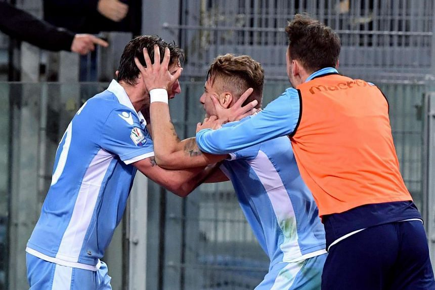 Lazio's Ciro Immobile (centre) celebrates with his teammates after scoring the 2-0 goal during the Italian Cup first leg semifinal soccer match between SS Lazio and AS Roma at the Olimpico stadium in Rome, Italy, on March 1, 2017.