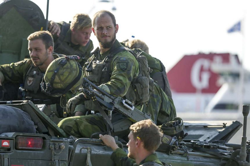 160-man combat team from the Swedish Army's Skaraborg Armoured Regiment arriving at Visby harbor for a military maneuver on the island of Gotland, on Sept 14, 2016.