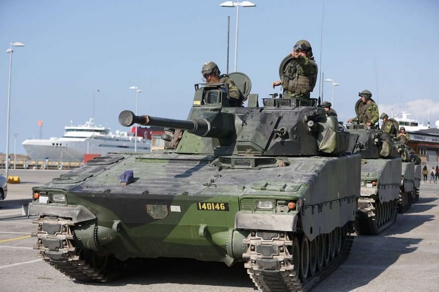 Swedish Armoured Personnel Carriers during a military manoeuvre in Visby, on the island of Gotland, on Sept 14, 2016.