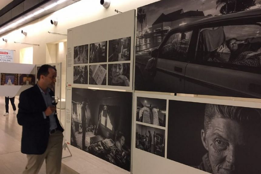 A visitor look at the photos on display during the World Press Photo exhibition launch on March 2, 2017.