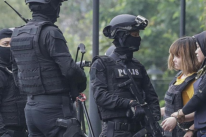 Vietnamese suspect Doan Thi Huong, 28, was clad in a bulletproof vest as she was escorted out of a Malaysian court complex yesterday, where she and Indonesian Siti Aisyah, 25, were charged with the murder of Mr Kim Jong Nam, the half-brother of North